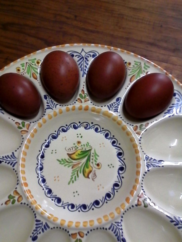 Beautiful egg holder with 4 eggs from my sister's Maran hens - stunning colours