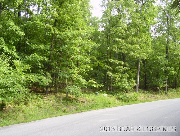 Lake View and Lake Access Building lot in the Grand Point Subdivision in Porto Cima. Gentle Wooded Lot with Water, Sewer and Electric available. Paved Roads. Golf membership can be purchased. All the Four Season amenities include Yacht Club, pools, tennis courts, clubhouse, and boat ramp. Close to the community bridge in Porto Cima MO