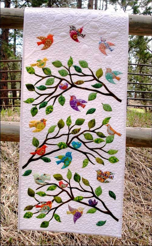Branch and leaves in this pattern are made from batiks and the background is white Kona cotton. Use colorful, crazy fabric for the birds. GO! Dies Used in