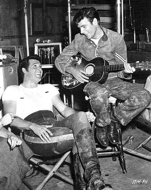 "Rock Hudson enjoys James Best's guitar playing on the set of ""Seminole,"" 1953."