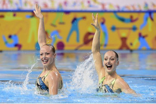Canada's Karine Thomas, right, and Jacqueline Simoneau compete in the duet synchronized swim free finals in Toronto. They have earned a ticket to the Rio Olympics.