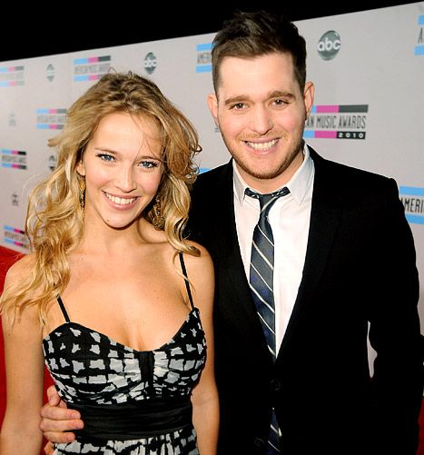 Luisana Lopilato and Michael Buble arrive at the 2010 American Music Awards at Nokia Theatre L.A. Live on November 21, 2010.