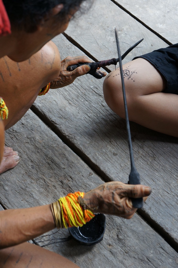 Skin art: Tattooing using a needle and a mixture of sugarcane and charcoal as ink is a dying art in Mentawai as the younger generation is increasingly reluctant to adopt the tribe's artistic symbols due to the pain involved in the process. Photo by Keshie Hernitaningtyas.