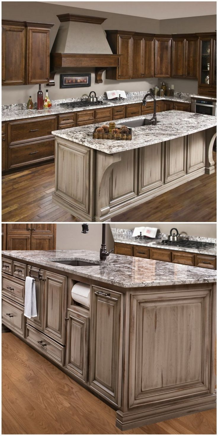 Notice the coordinating corbels on the hood and island in this dual-colored kitchen. #kitchen #kitchendesign