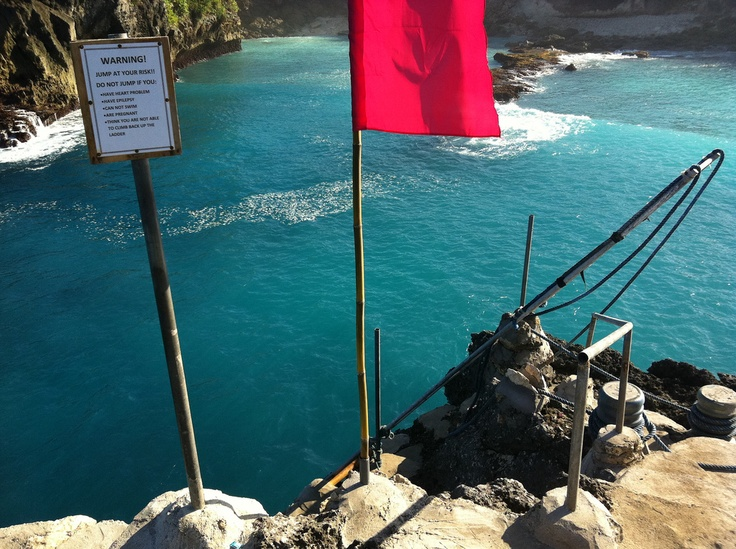 """""""Jump at your own risk"""" - Jumping Rock (Cliff Jumping) at Nusa Ceningan   Bali - Indonesia    This is exactly what is sounds like. A cliff top point where you can leap into turquoise water below."""
