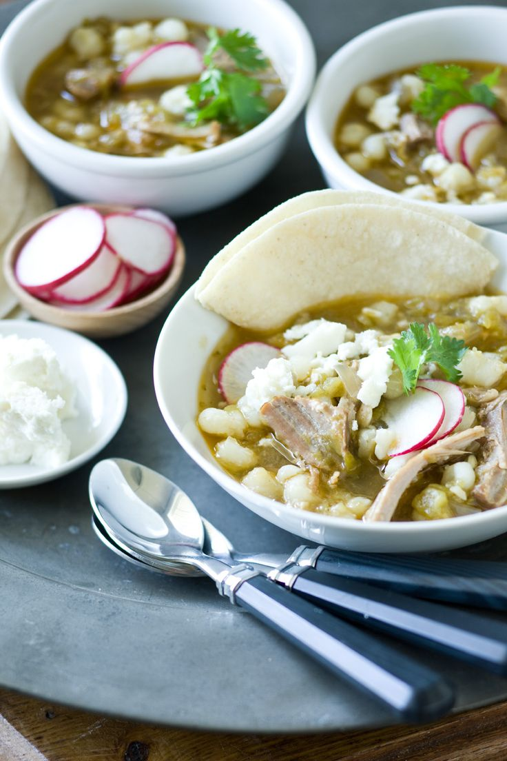 {Posole} One of my favorite soups. Freeze pork with sauce, onions, peppers, and spices. Add broth in the A.M., then finish with hominy and adobo sauce. I would also serve this with lime wedges and cilantro.