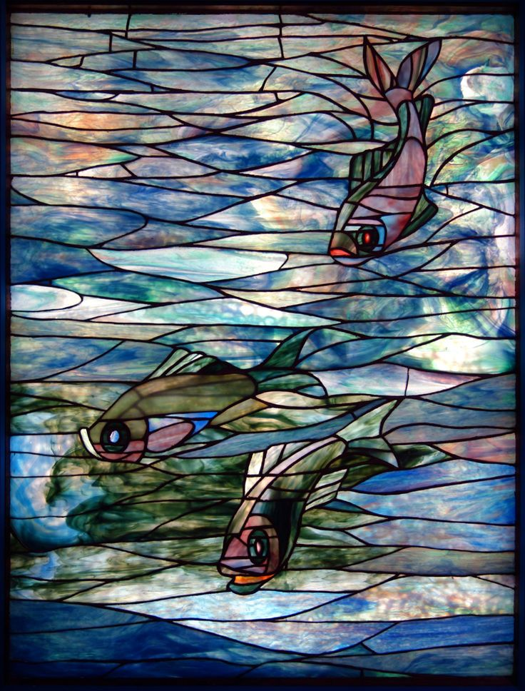 Stained glass window featuring fish, designed by the Tiffany Glass Company (c.1890).