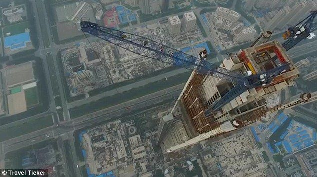 World's tallest: Russian thrill seekers Ivan Kuzenetsov, 22, and Angela Nikolau, 23, scaled the Goldin Finance 117 in Tianjin, China