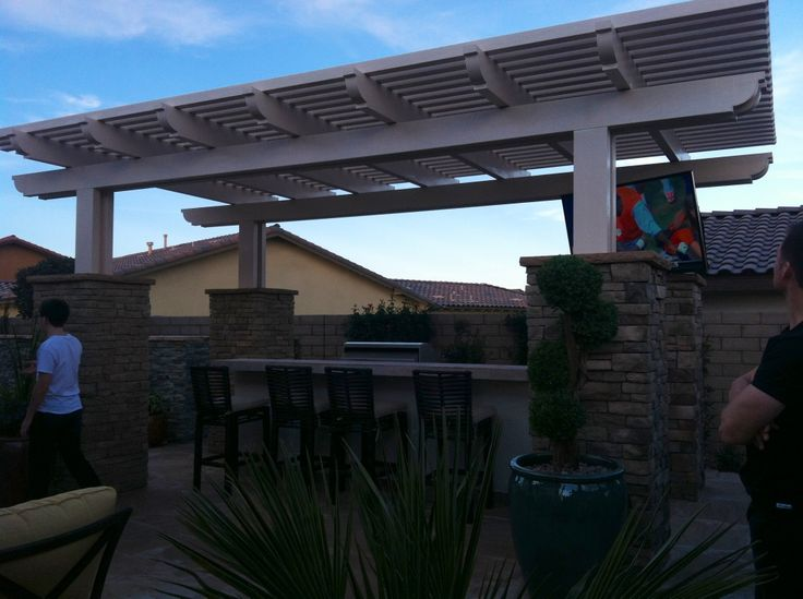 Covered bbq area backyard inspiration pinterest for The most believable architectural stone veneer