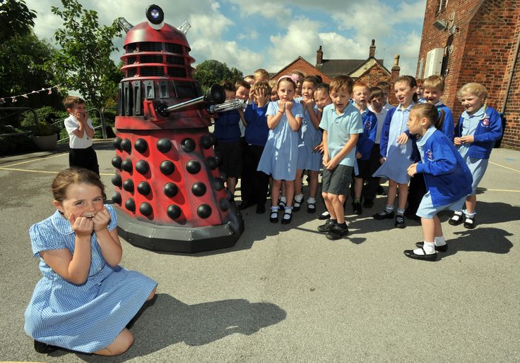 HELP ME DOCTOR . . . Isabel Edwards tries to hide from a Dalek during an attempted invasion at St Georges Primary School.