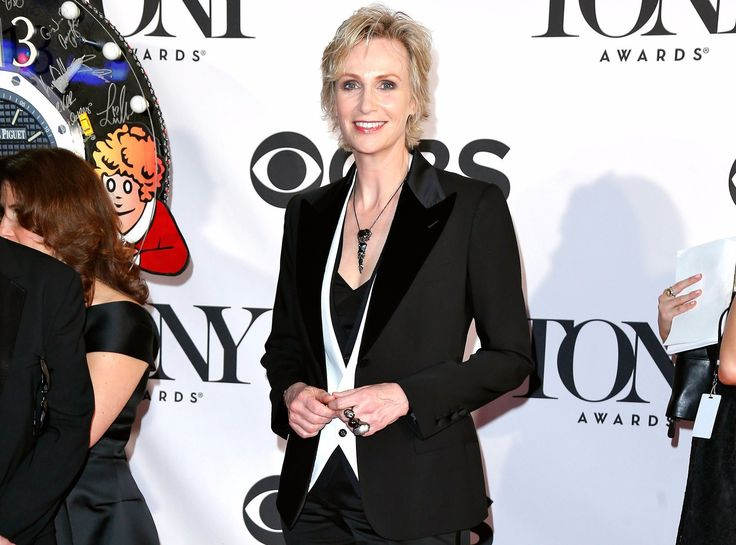 Jane Lynch in 2013 at 67th Tony Award. She is wearing a black suit along with a white waistcoat.