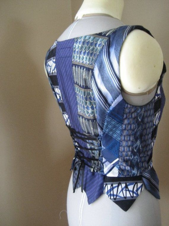 Form fitting vest made from several neck ties    Rich shades of blue    Black ribbon tie closure in front and ties to cinch in the waist at back