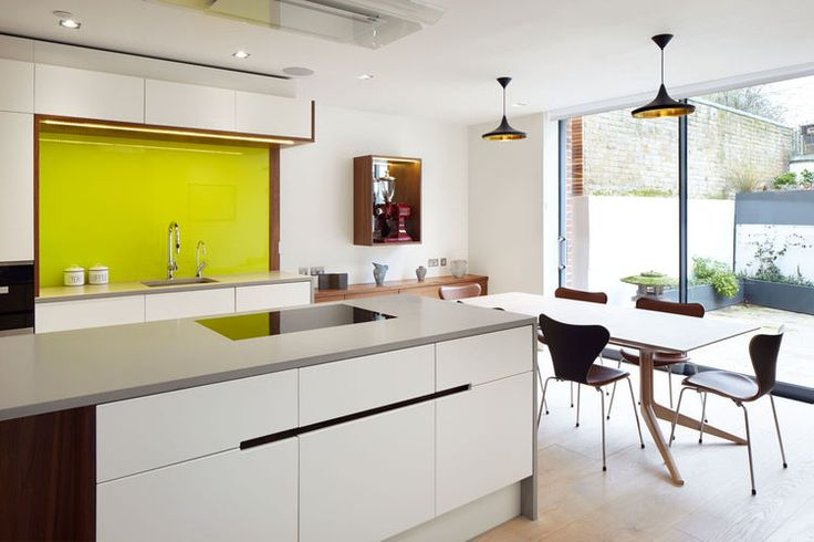 Sunny kitchen and dining room with Ligne Roset furniture