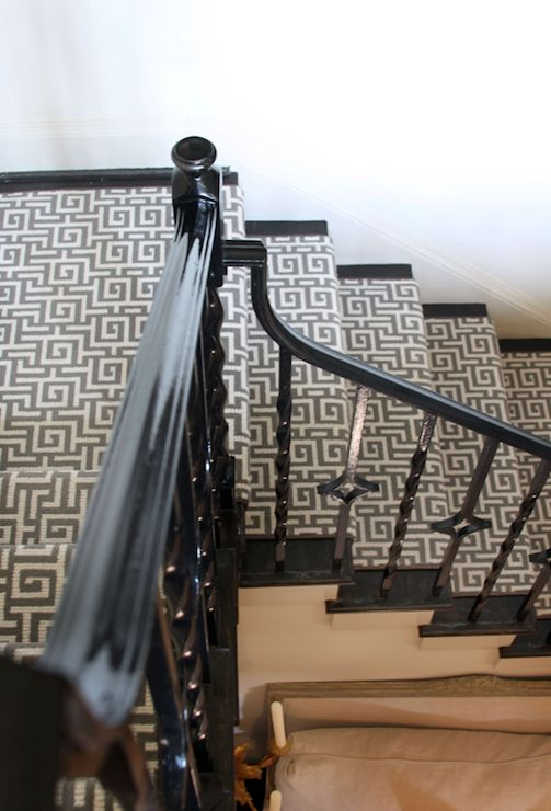 Stairwell with glossy black iron spindles and staircase banister and gray Greek key ...