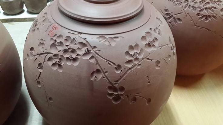 plum blossom carving into leather hard clay
