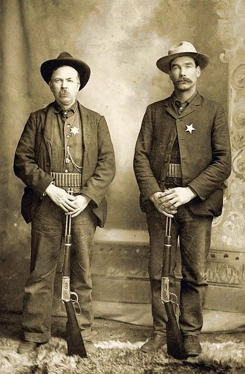 CABINET OF TWO LAWMEN AND THEIR GUNS, ca 1890-1900. Handsome image of two unnamed lawmen posing proudly with their Winchesters.