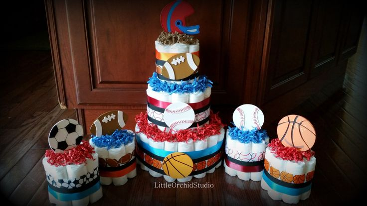 Sports Diaper Cake/ Boys Diaper Cake/ Baby Shower Center Pieces/ Sports Theme Baby Shower Decor/ Sports Theme/ Mommy To be/ Football Mom by LittleOrchidStudio on Etsy https://www.etsy.com/listing/217770274/sports-diaper-cake-boys-diaper-cake-baby