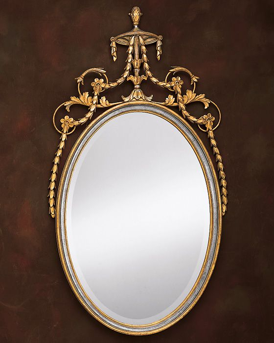 Adam style oval wall mirror finished in gold and silver leaf