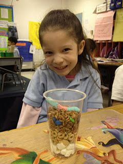 Rock experiment -- layers of soil activity marshmallows = bedrock Cheerios = subsoil (crumbled near the top) chocolate rice crispies for top soil mini-M for humus with gummy worms