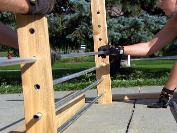 conduit fence. weave fabric in and out or just use conduit at top and bottom to hold drapery in place