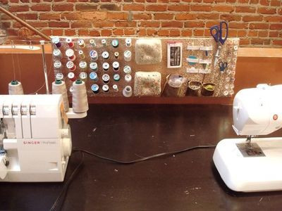Mounted Sewing Room Idea - um... this is a fantastic DIY. Learn how to create a board for your tools here!