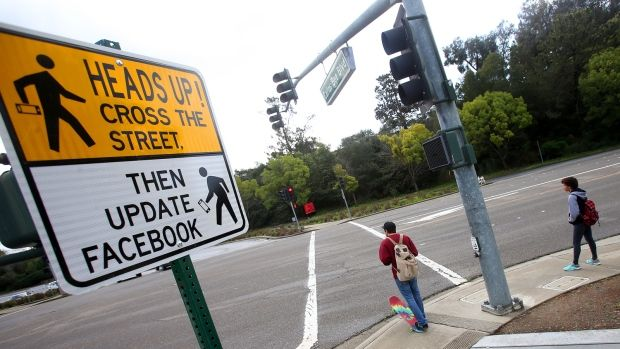 Quirky traffic signs urge drivers, pedestrians to pay attention (USA)