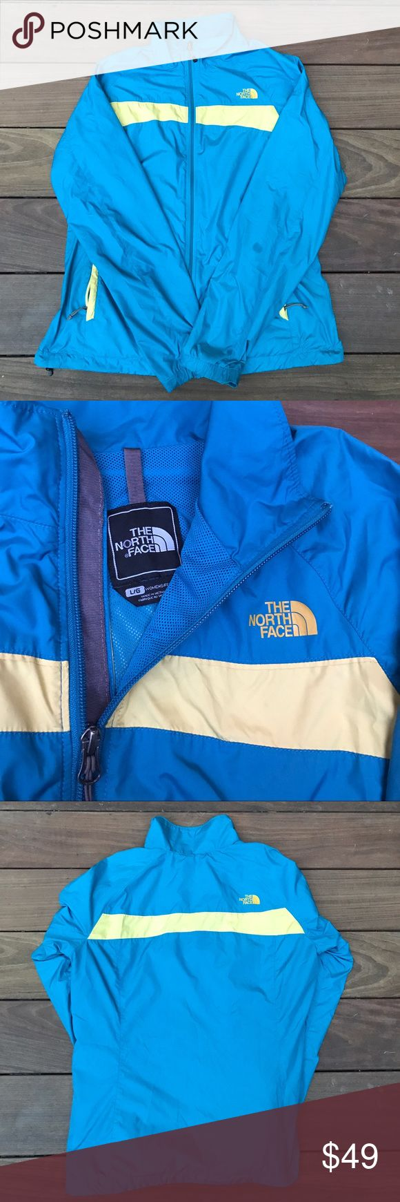 Northface zip-up windbreaker Blue & yellow Northface zip-up windbreaker. Has ink stains on one of the sleeves but has no other flaws and is still useable! Size women's large. The North Face Jackets & Coats