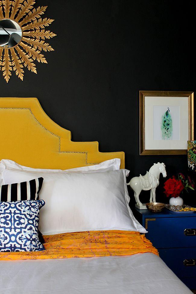 Swoon Worthy - black bedroom with yellow velvet headboard