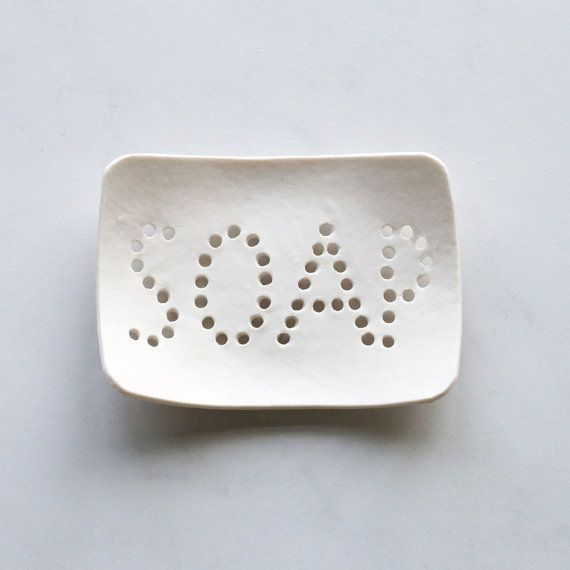Holey soap dish. White porcelain, typo holes, bath…