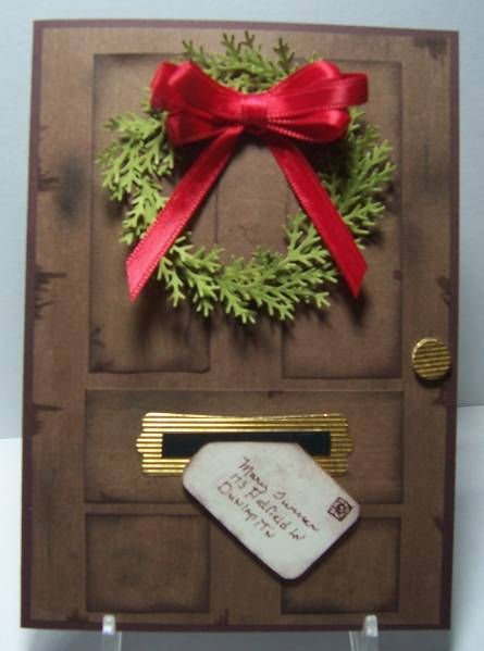 handmade Christmas card ... Door with Wreath and Letter ... panel door ... letter coming through the mail ... punched foliage ... multi-loop red bow
