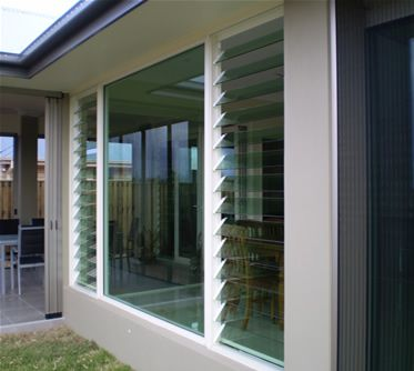 A mix of louvered and solid glass windows