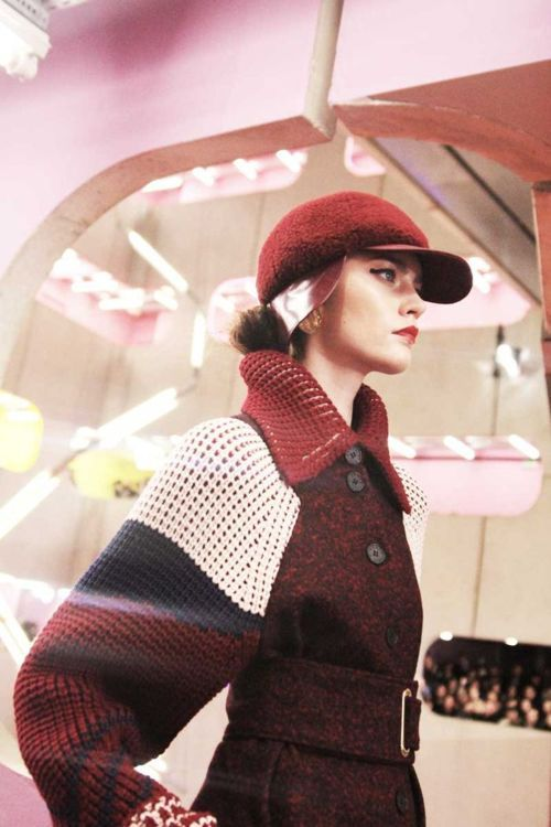 So unexpected...Exagerrated knit sleeve on wool coat. Kenzo Fall 2012