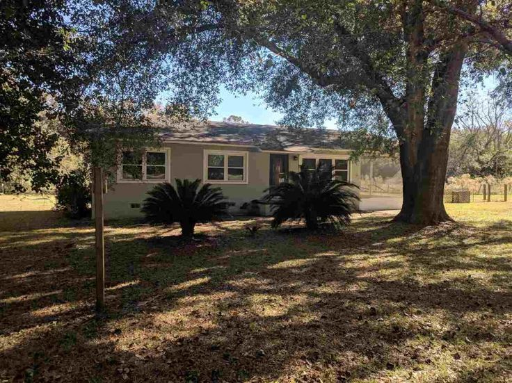Great home on an acre, surrounded by pasture land fronting on hwy 59 a very short distance from Hwy 90. 3 bed, 1 bath, screen porch could easily be converted back to carport. Metal/wire Fenced backyard includes an aluminum shed with a plywood floor, this home has what you need.