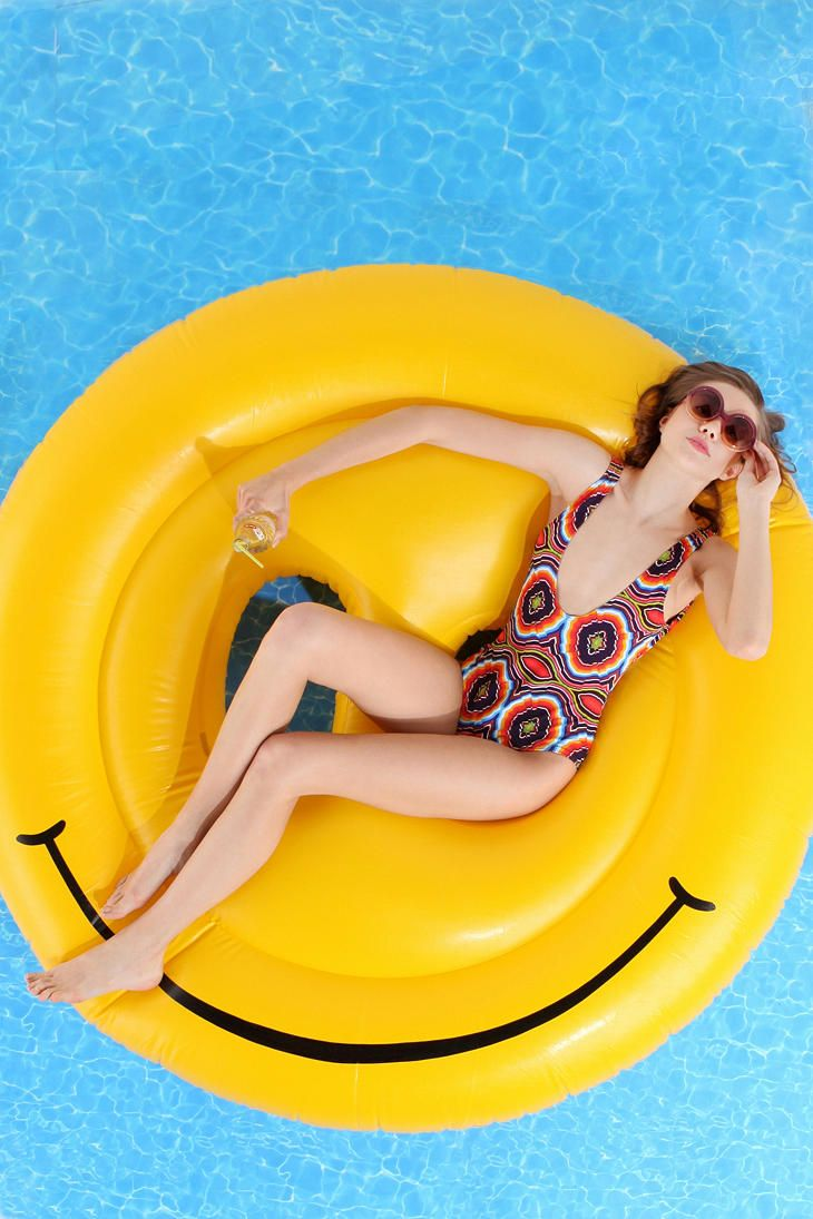 Big kid floatie. UrbanOutfitters.com > Smiley Face Pool Float