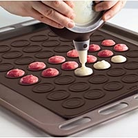 """Macaron Baking Mat  Keep all your macaron shells uniform in shape and size with this nonstick silicone baking mat. Pure silicone sheet has marks and edges to form 48 French macaron halves (1-1/2"""" dia.). 11-7/8"""" x 15-1/2"""", brown."""