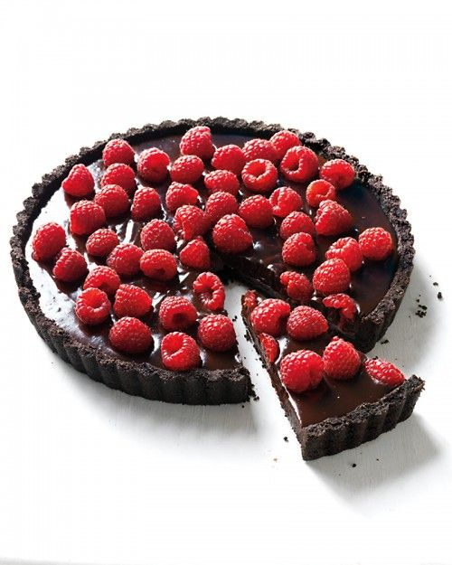 Chocolate-Raspberry Tart. So delicious and decadent...you only need to eat a tiny slice! I add an extra package of raspberries to the chocolate mixture in addition to putting them on top.