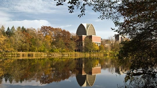 The Genesee River and the Interfaith Chapel on the University of Rochester campus in Rochester, New York