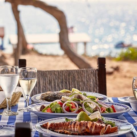 Fresh seafood enjoyed the proper way: with Greek salad and some white wine by the beach! #restaurant #grecianbay #tavern #delicious #fishermanshut #grecianbayhotel #seaside #mediterranean #bythesea #ayianapa #hotel #cyprus