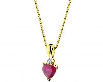Zawieszka z żółtego złota z diamentem i rubinem syntetycznym.Niezwykła barwa rubinu.