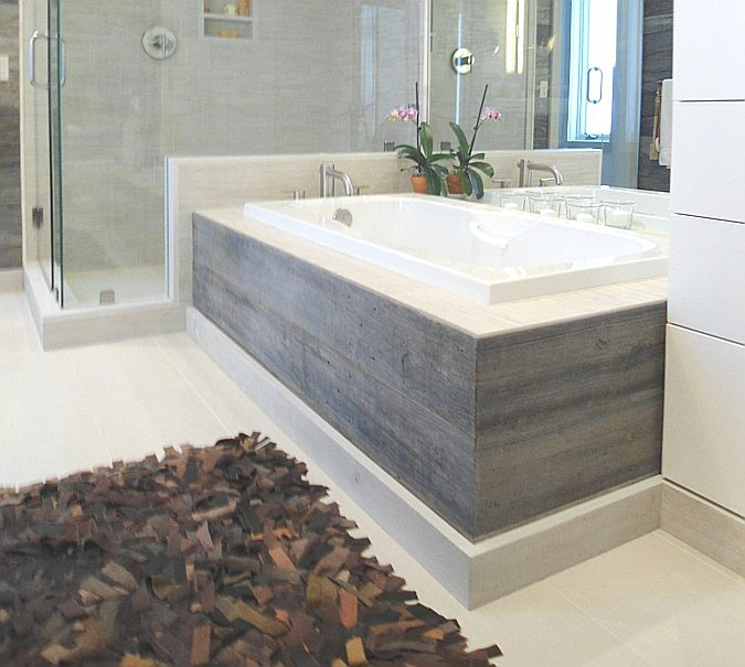 Reclaimed barn wood wraps platform tub
