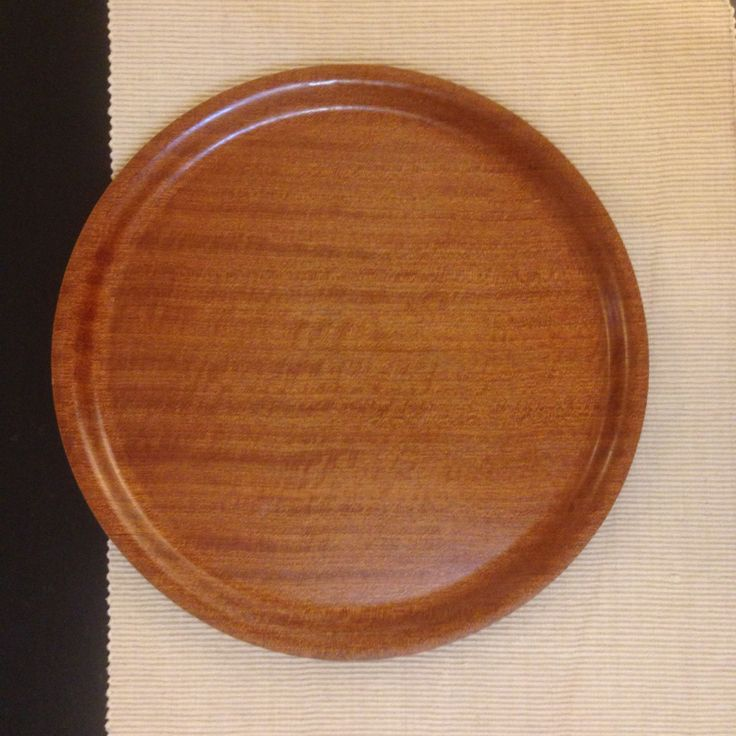 "From my mid century modern collection. Large Backman of Finland round teak veneer serving tray. Construction appears to be some sort of plywood with layer of teak on both sides. Nice looking Scandinavian modern piece, probably 1960s or so production. Marked on reverse with ""Backman Made in Finland"". #midcenturymodern #backmanfinland #teakservingtray"
