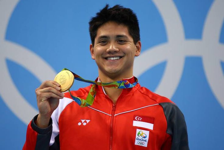 Joseph Schooling of Singapore celebrates winning the gold medal in the Men's 100m Butterfly Final on Day 7 of the Rio 2016 Olympic Games at the Olympic Aquatics Stadium on August 12, 2016 in Rio de Janeiro, Brazil. (Photo by Clive Rose/Getty Images)