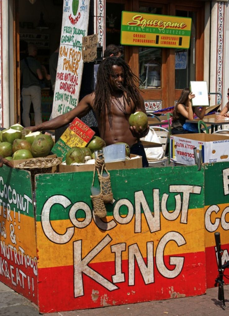 Coconut King selling fresh coconuts in the summer time on Portobello.