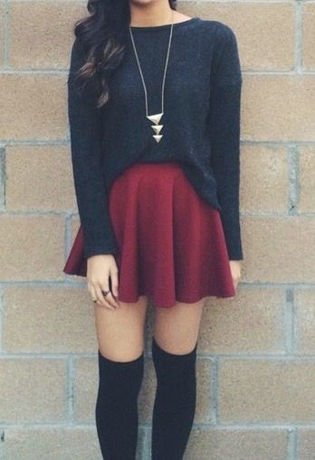 a black sweater with a long necklace and red skirt skater skirt are great accompanied with black knee high socks. maybe short boots for the feet.: