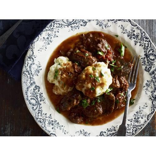 Beef casserole with cheesy herb dumplings recipe - By Australian Women's Weekly, Stay cosy indoors this weekend with this hearty, slow-cooked beef casserole topped with dumplings. A side order of mash and greens completes the meal.