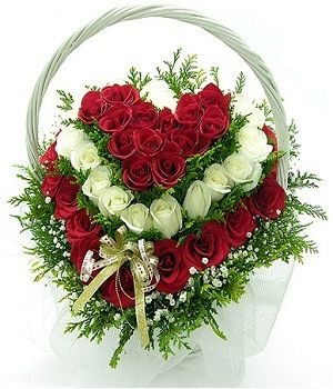 Heart Shape Flower Basket arranged by 12 white roses and 24 red roses with baby's breaths and greeny fillers. It is decorated with lovely prastic papers and ribbons.