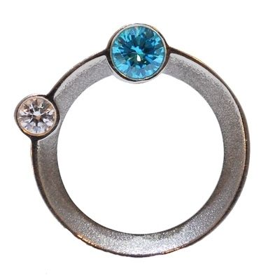 This distinctive sterling silver ring features semi precious stones set on the side of the ring orbiting around the finger #unusual #wedding #rings #London #Nude #Jewellery