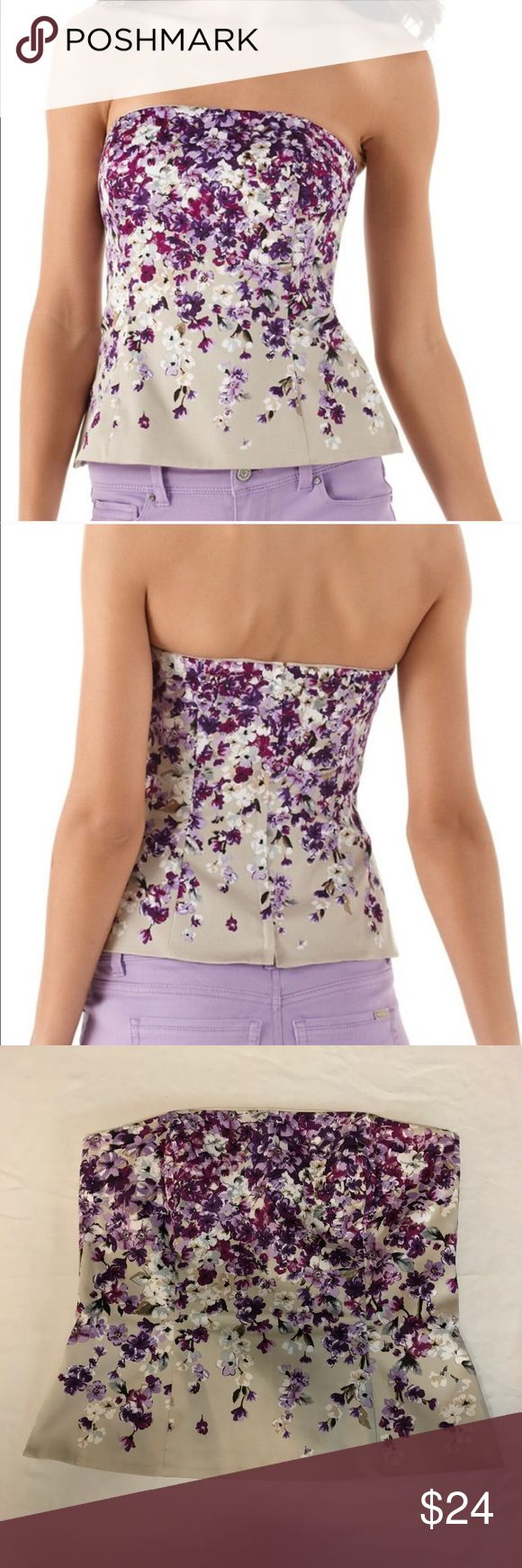 WHBM Cream and Floral Print Strapless Bustier Top White House Black Market. Size 8. Cream bustier top with purple floral print. Strapless. Slight Peplum flare out. Fully lined. Zipper down the back. Excellent used condition. Bust: 16.5 inches. Length: 15.5 inches. Waist: 15.5 inches. ALL MEASUREMENTS ARE TAKEN WITH ITEM LAYING FLAT. Shell: 98% cotton, 2% spandex. Lining: 95% polyester, 5% spandex. ||520|| White House Black Market Tops