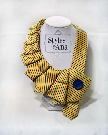 A new twist on the old tie! :) The upcycled neckties make a bold statement and add a little pizzazz! to your everyday wardrobe. Try it with the