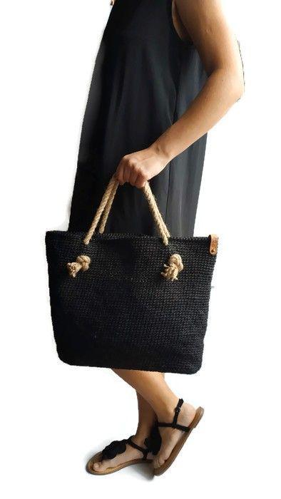 Handwoven beach bag from black jute twine with beige jute